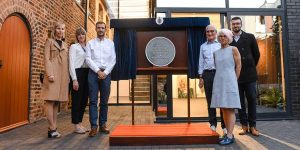 6 people stand around a grey plaque unveiling, Birmingham Civic Society Renaissance Award Winner Plaque Unveiling